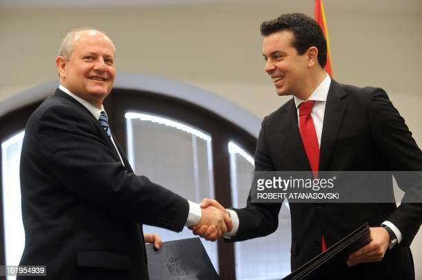 Serbia's Foreign Minister Ivan Mrkic shakes hands with his Macedonian counterpart Nikola Poposki after their meeting in Skopje on February 18 2013...