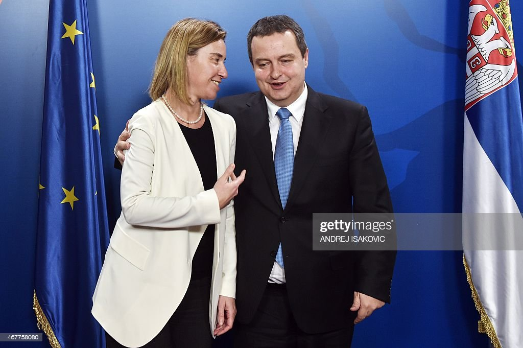 Serbia's Foreign Minister Ivica Dacic (R) welcomes European Union foreign policy chief Federica Mogherini (L) prior to their meeting in Belgrade on March 27, 2015.