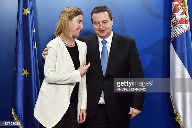 Serbia's Foreign Minister Ivica Dacic welcomes European Union foreign policy chief Federica Mogherini prior to their meeting in Belgrade on March 27...