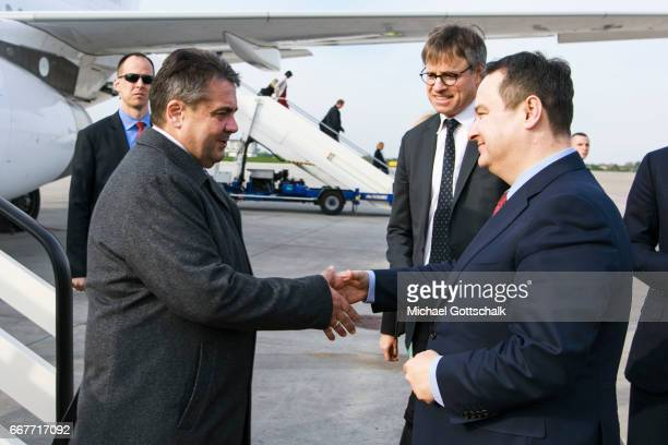 Serbias Foreign Minister Ivica Dacic welcomes German Foreign Minister and Vice Chancellor Sigmar Gabriel at the airport during his visit to Serbia on...