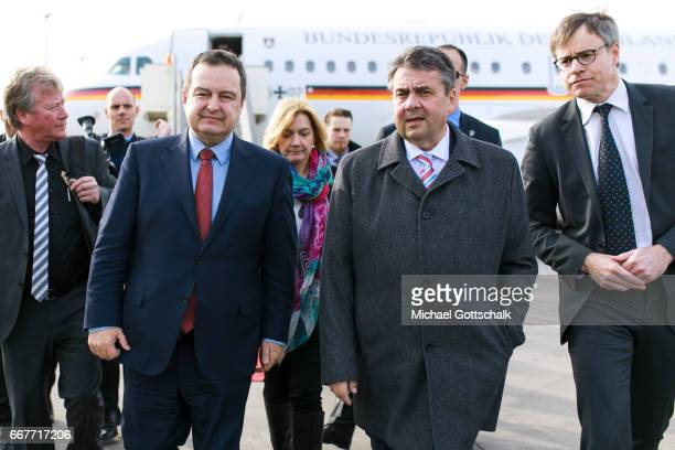 Serbia's Foreign Minister Ivica Dacic welcomes German Foreign Minister and Vice Chancellor Sigmar Gabriel at the airport during his visit to Serbia...