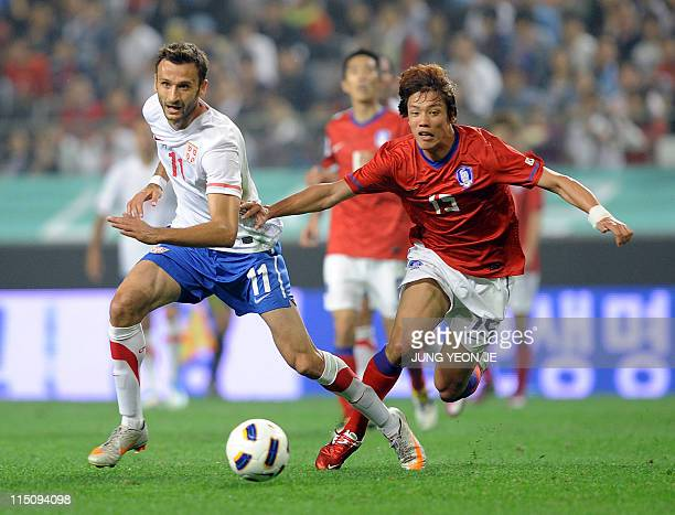 Serbia's forward Jovan Damjanovic fights for the ball with South Korea's defender Hong JeongHo during their friendly football match in Seoul on June...
