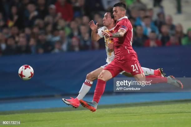 Serbia's forward Nemanja Radonjic and Spain's defender Alvaro Odriozola vie for the ball during the UEFA U21 European Championship Group B football...