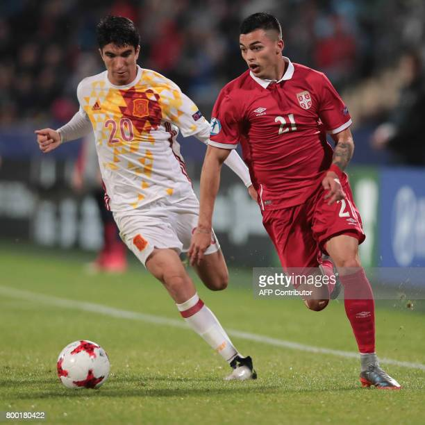 Serbia's forward Nemanja Radonjic and Spain's midfielder Carlos Soler vie for the ball during the UEFA U21 European Championship Group B football...