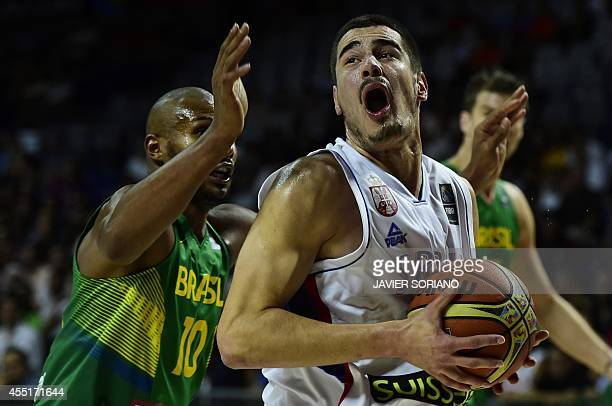Serbia's forward Nikola Kalinic vies with Brazil's guard Leandrinho Barbosa during the 2014 FIBA World basketball championships quarterfinal match...