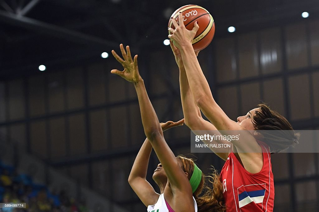 TOPSHOT Serbia's forward Sonja Petrovic takes a shot over Senegal's shooting guard Oumoul Thiam during a Women's round Group B basketball match...