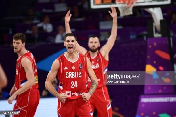 Serbia's forward Stefan Jovic and Milan Macvan celebrate after scoring during the FIBA Eurobasket 2017 men's Semi Final basketball match between...