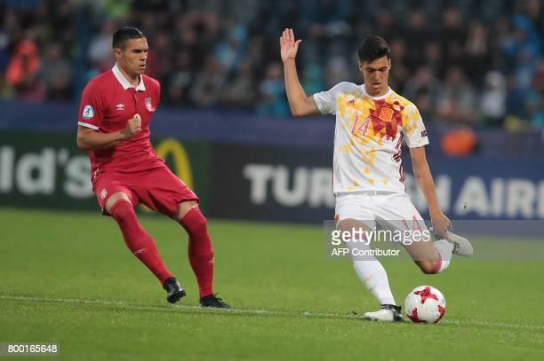 Serbia's forward Uros Djurdjevic and Spain's midfielder Mikel Merino vie for the ball during the UEFA U21 European Championship Group B football...