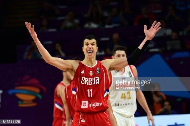 TOPSHOT Serbia`s forward Vladimir Milosavljevic celebrates after scoring a basket during the FIBA Eurobasket 2017 men`s Semi Final basketball match...