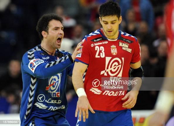 Serbia's goalkeeper Darko Stanic encourages team mate Nenad Vuckovic during the men's EHF Euro 2012 Handball Championship final Serbia vs Denmark on...