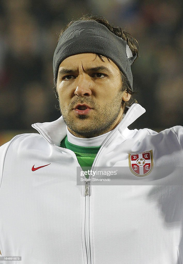Serbia's goalkeeper Vladimir Stojkovic sings national anthem before the FIFA 2014 World Cup Qualifier match between Serbia and Scotland at Karadjordje Stadium on March 26, 2013 in Novi Sad, Serbia