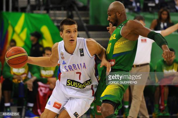 Serbia's guard Bogdan Bogdanovic vies with Brazil's guard Leandrinho Barbosa during the 2014 FIBA World basketball championships group A match Serbia...