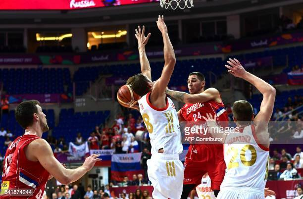 Serbia`s guard Stefan Jovic fights for the ball with Russia`s forward Vladimr Ivlev and forward Andrey Vorontsevich during the FIBA Eurobasket 2017...