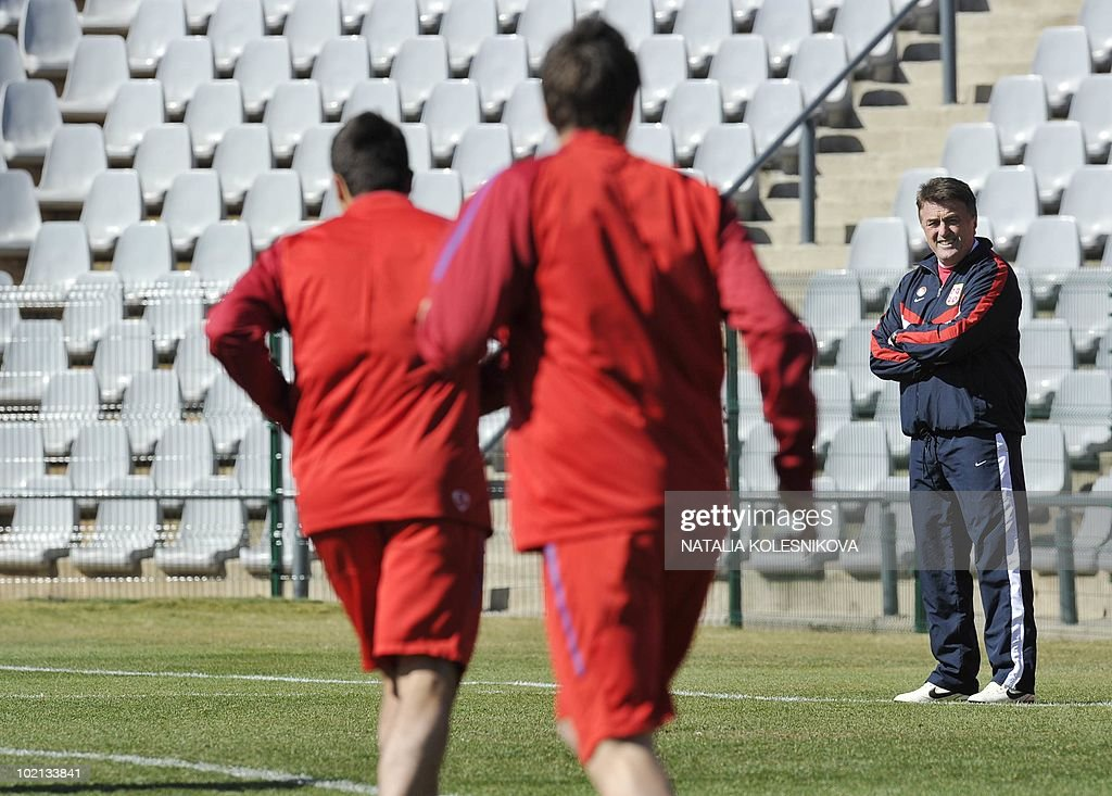 Serbia's head coach Radomir Antic (R) watches his players during a training session at the Rand stadium in Johannesburg, on June 16, 2010 during the 2010 World Cup in South Africa.