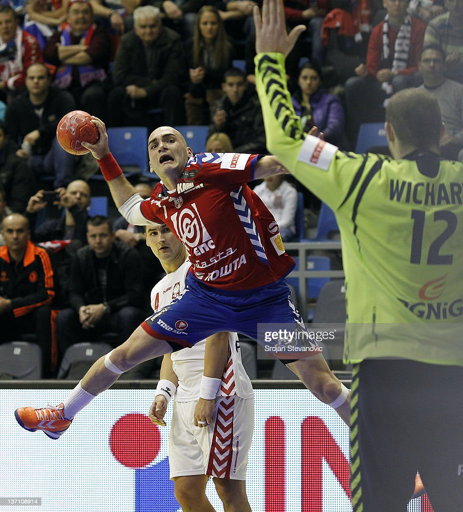 Serbia's Ivan Nikcevic (L) in action against Poland Marcin Wichary (R) during the Men's European Handball Championship group A match between Poland and Serbia at Pionir Sports Centre on January 15, 2011 in Belgrade, Serbia.