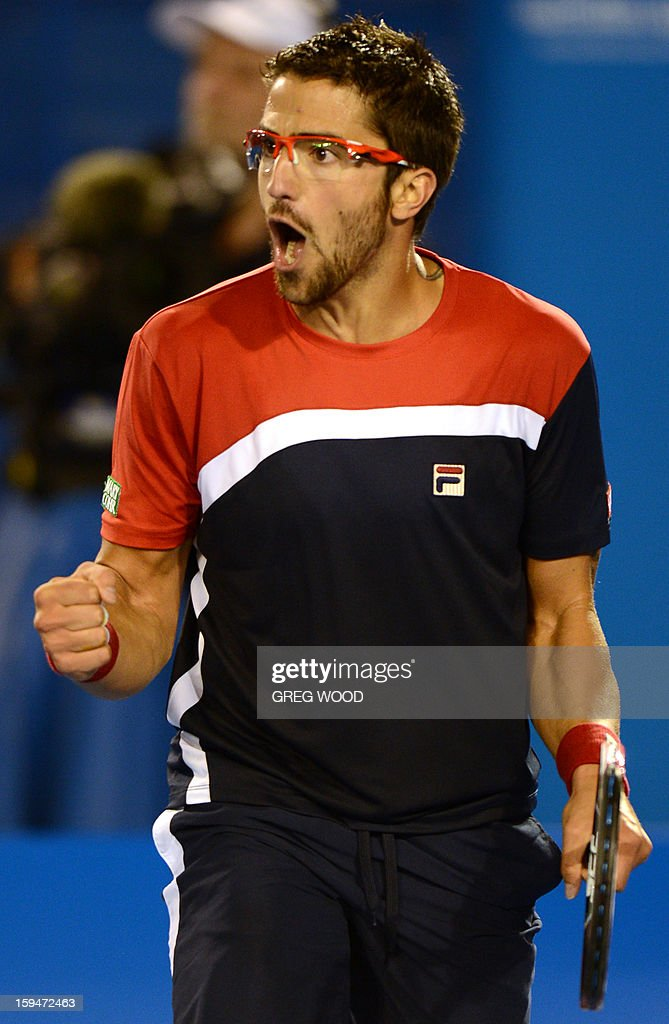Serbia's Janko Tipsarevic reacts during his men's singles match against Australia's Lleyton Hewitt on first day of the Australian Open tennis tournament in Melbourne on January 14, 2013.