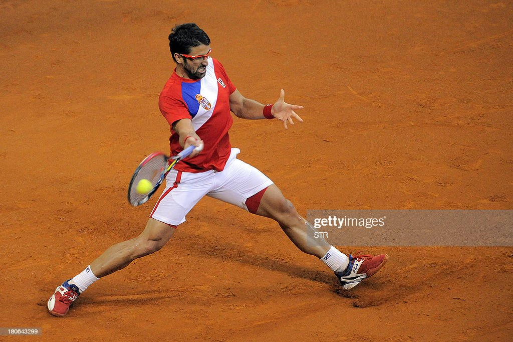 Serbia's Janko Tipsarevic returns the ball to Canada's Vasek Pospisil during their Davis Cup semi-final match at Belgrade Arena on September 15, 2013. Serbia, the 2010 champions, will host the November 15-17 final against the Czechs who defeated Argentina 3-2 in their semi-final in Prague.