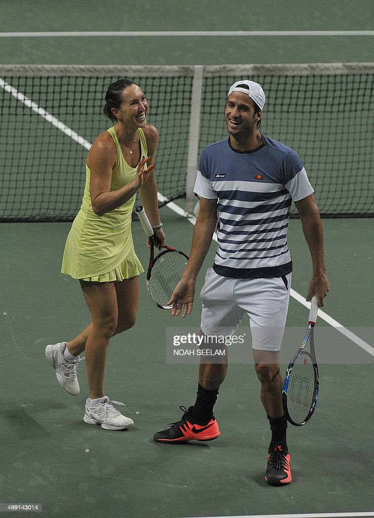 Serbia's Jelena Jankovic and Spain Feliciano Lopez of Nagpur Orangers celebrate a point during their mixed doubles match against Switzerland's...