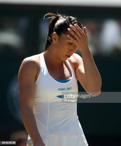 Serbia's Jelena Jankovic gestures in her match against Denmark's Caroline Wozniacki during the Wimbledon Championships 2008 at the All England Tennis...