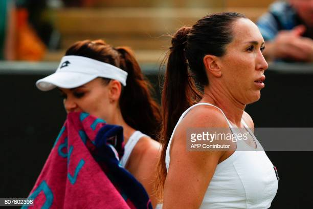 Serbia's Jelena Jankovic reacts as she changes ends after a game against Poland's Agnieszka Radwanska during their women's singles first round match...