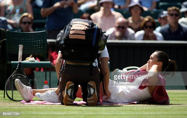 Serbia's Jelena Jankovic receives treatment for a injury on court during the Wimbledon Championships 2008 at the All England Tennis Club in Wimbledon