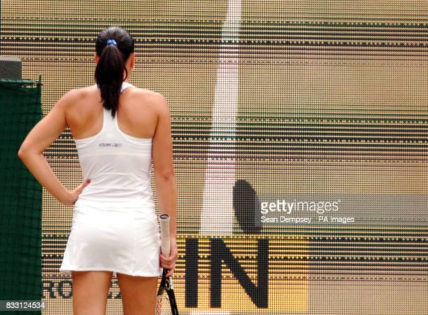 Serbia's Jelena Jankovic watches the replay on the giant screen during the ladies singles match against Czech Republic's Lucie Safarova during The...