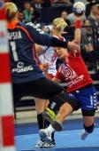 Serbia's Katarina Krpez attempts to score against Poland's goalkeeper Malgorzata Gapska during the 2013 Women's Handball World Championship semifinal...