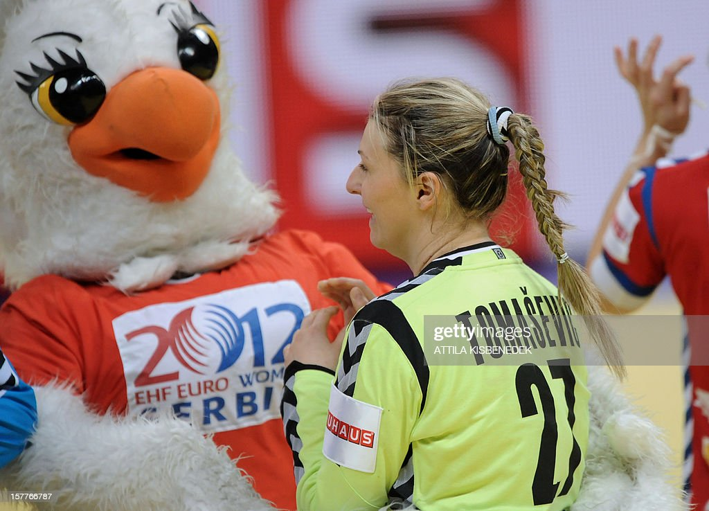 Serbia's Katarina Tomasevic, ''best player of the match '' (R) celebrates her team's victory against Ukraine at the end of the 2012 EHF European Women's Handball Championship match on December 6 , 2012, at the KOMBANK Arena in Belgrade. Serbia won 25-23.