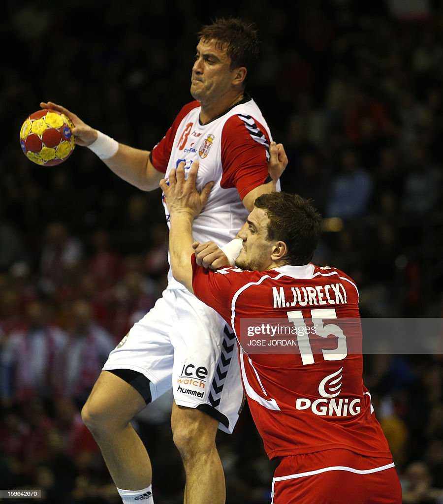 Serbia's left back Momir Ilic (L) vies with Poland's left back Michal Jurecki during the 23rd Men's Handball World Championships preliminary round Group C match Poland vs Serbia at the Pabellon Principe Felipe in Zaragoza on January 17, 2013.