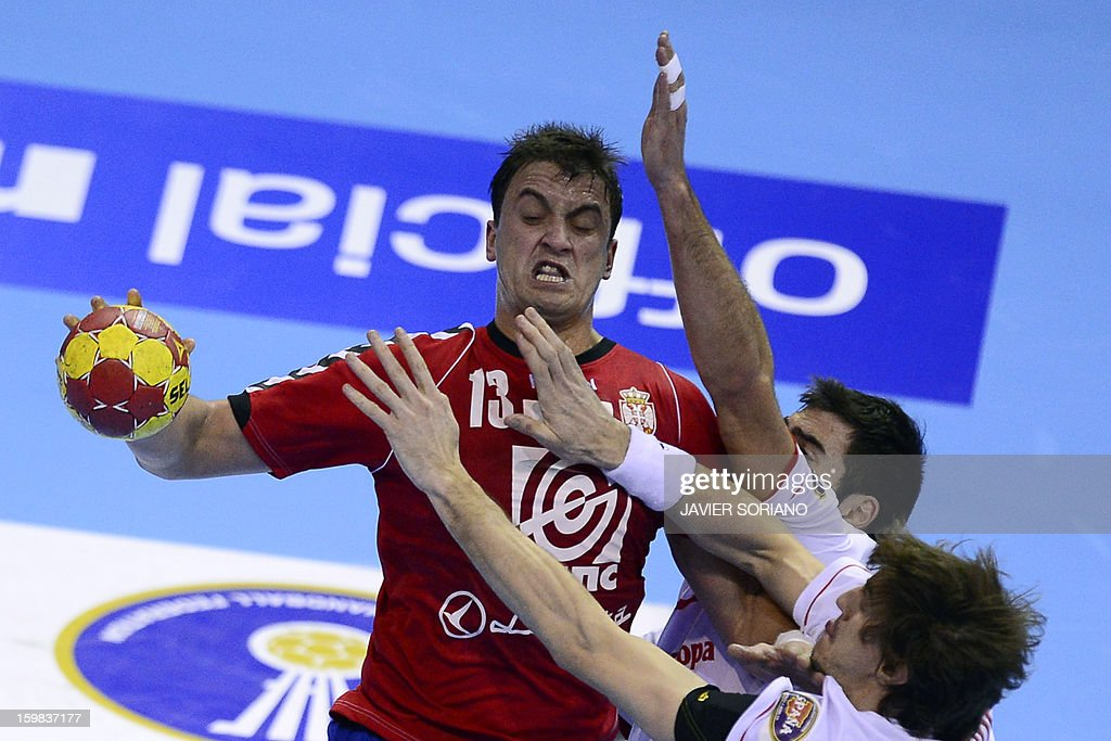Serbia's left back Momir Ilic (L) vies with Spain's left back Viran Morros (R) during the 23rd Men's Handball World Championships round of 16 match Serbia vs Spain at the Pabellon Principe Felipe in Zaragoza on January 21, 2013.