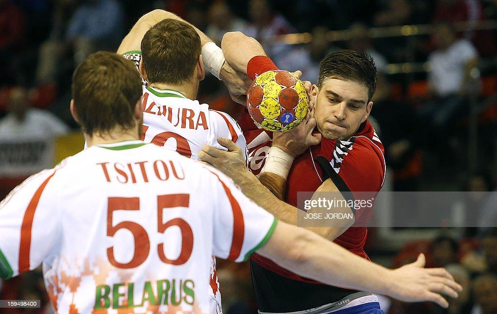 Serbia's leftback Zarko Sesum (R) vies with Belarus players during the 23rd Men's Handball World Championships preliminary round Group C match Belarus vs Serbia at the Pabellon Principe Felipe in Zaragoza on January 14, 2013.