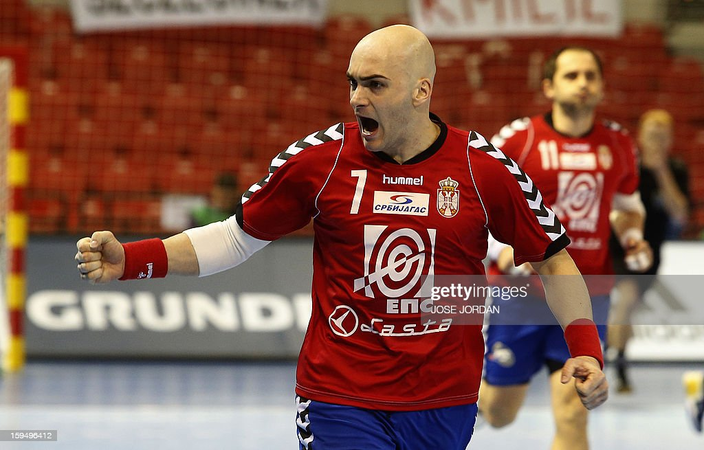 Serbia's leftwing Ivan Nikcevic celebrates a goal during the 23rd Men's Handball World Championships preliminary round Group C match Belarus vs Serbia at the Pabellon Principe Felipe in Zaragoza on January 14, 2013. AFP PHOTO/ JOSE JORDAN