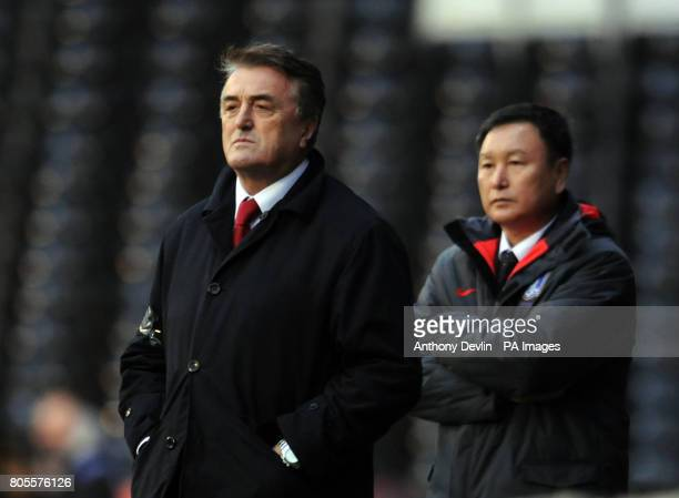 Serbia's manager Radomir Antic and Korea's manager Huh Jung Moo on the touchline during the International Friendly at Craven Cottage London