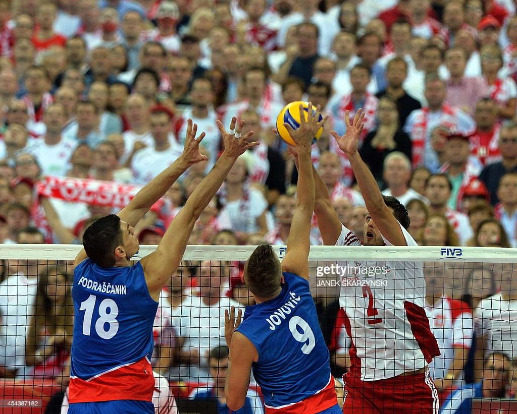 Serbia's Marko Podrascanin and Nikola Jovovic spikes against Poland's Michal Winiarski during the opening match of the FIVB Mens Volleyball World...