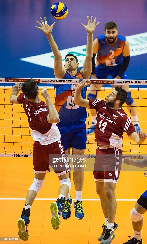Serbia's Marko Podrascanin spikes the ball during the pool A match Serbia vs Poland of the Men's Volleyball Qualification tournament for the 2016...