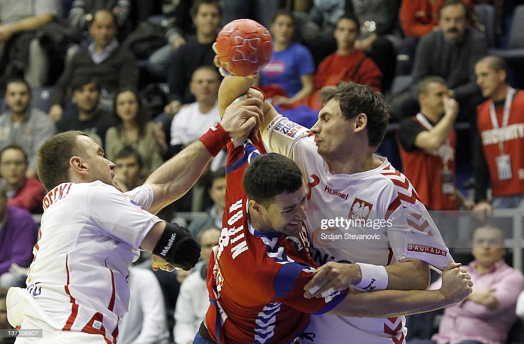 Serbia's Marko Vujin in action against Poland <a gi-track='captionPersonalityLinkClicked' href=/galleries/search?phrase=Krzysztof+Lijewski&family=editorial&specificpeople=842972 ng-click='$event.stopPropagation()'>Krzysztof Lijewski</a> (R) during the Men's European Handball Championship group A match between Poland and Serbia at Pionir Sports Centre on January 15, 2011 in Belgrade, Serbia.