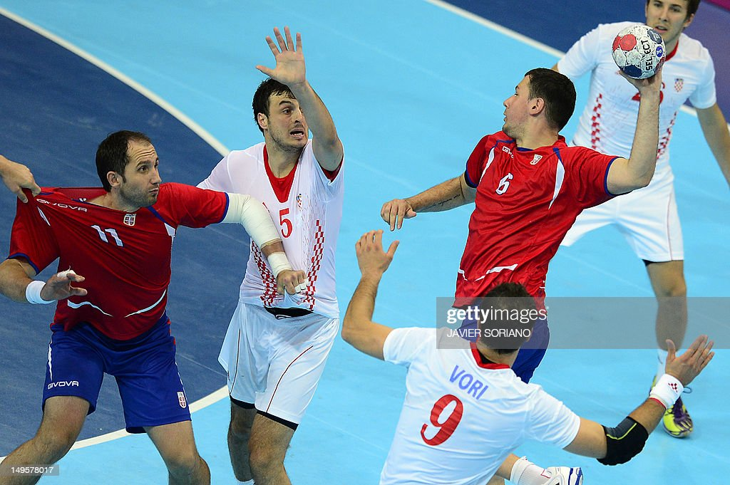 Serbia's Marko Vujin (R) jumps to shoot as he faces with Croatia's Domagoj Duvnjak (C) and Serbia's Alem Toskic during the men's preliminaries Group B handball match Serbia vs Croatia for the London 2012 Olympics Games on July 31, 2012 at the Copper Box hall in London.