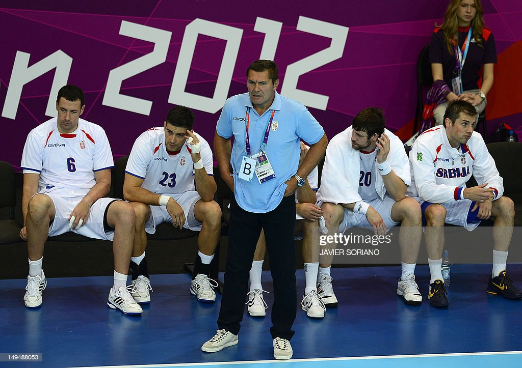 Serbia's Marko Vujin, Nenad Vuckovic, coach Veselin Vukovic and leftback Momir Rnic attend the men's preliminaries Group B handball match Spain vs Serbia for the London 2012 Olympics Games on July 29, 2012 at the Copper Box hall in London.