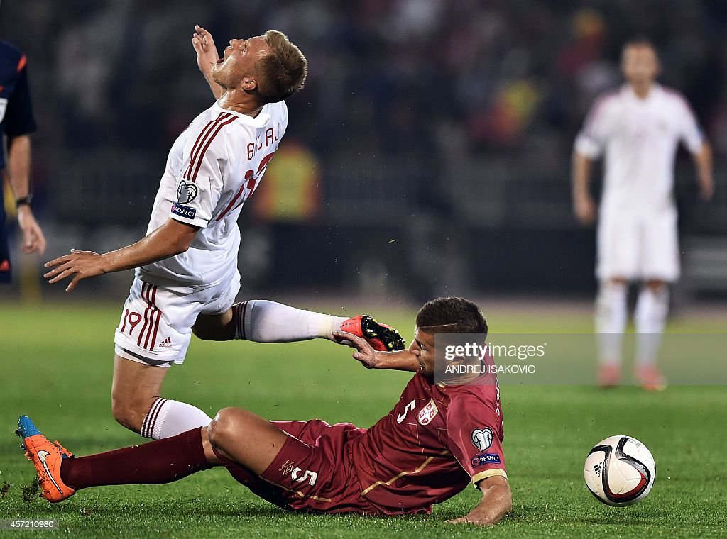 Serbia's Matija Nastasic vies with Albania's Bekim Balaj during the EURO 2016 group I football match between Serbia and Albania in Belgrade on...