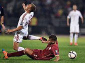 Serbia's Matija Nastasic vies with Albania's Bekim Balaj during the EURO 2016 group I football match between Serbia and Albania in Belgrade on...