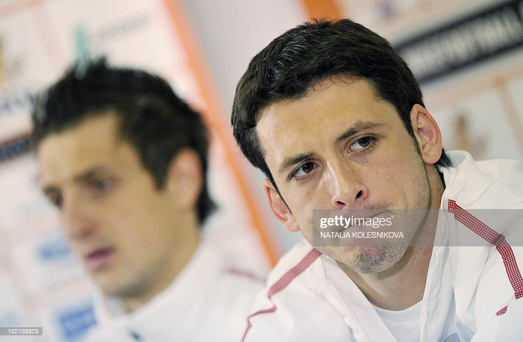 Serbia's midfielder Gojko Kacar (R) attends a press conference at the hotel in Johannesburg, on June 16, 2010 during the 2010 World Cup in South Africa.