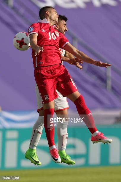 Serbia's midfielder Mijat Gacinovic and Macedonia's defender Mevlan Murati vie for the ball during the UEFA U21 European Championship Group B...