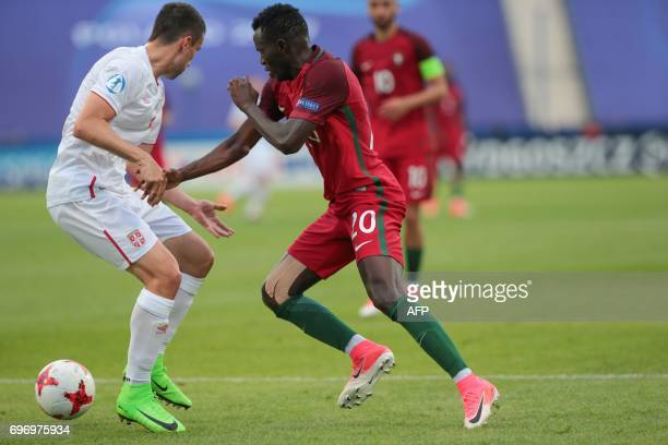 Serbia's midfielder Mijat Gacinovic and Portugal's midfielder Bruma vie for the ball during the UEFA U21 European Championship Group B football match...