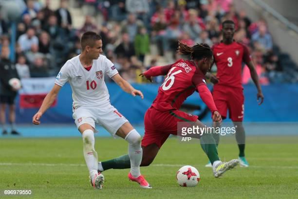 Serbia's midfielder Mijat Gacinovic and Portugal's midfielder Renato Sanches vie for the ball during the UEFA U21 European Championship Group B...