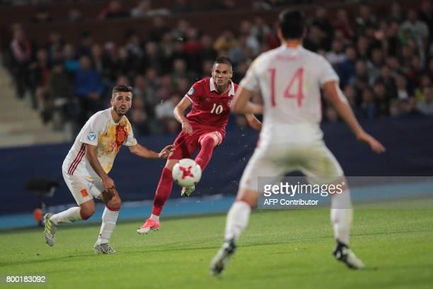 Serbia's midfielder Mijat Gacinovic and Spain's defender Jose Gaya vie for the ball during the UEFA U21 European Championship Group B football match...
