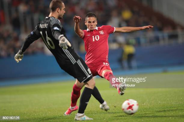 Serbia's midfielder Mijat Gacinovic and Spain's goalkeeper Pau vie for the ball vie for the ball during the UEFA U21 European Championship Group B...