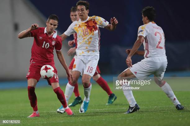 Serbia's midfielder Mijat Gacinovic and Spain's midfielder Mikel Oyarzabal vie for the ball during the UEFA U21 European Championship Group B...
