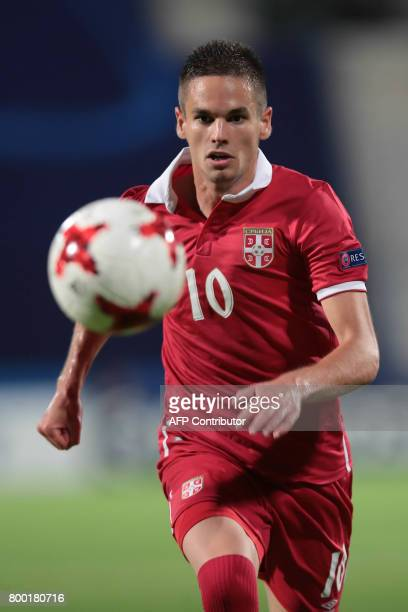 Serbia's midfielder Mijat Gacinovic plays the ball during the UEFA U21 European Championship Group B football match Serbia v Spain in Bydgoszcz...