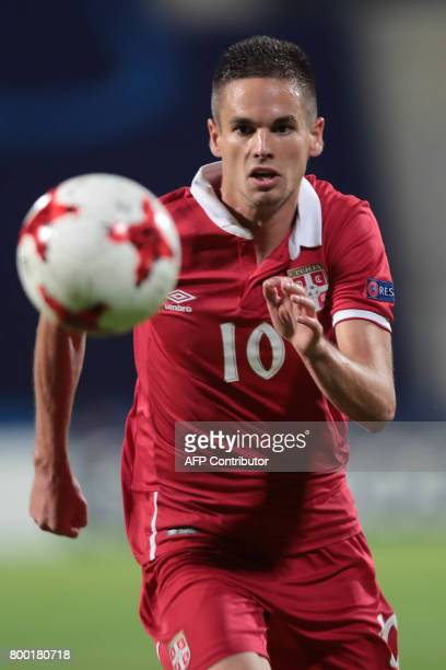 Serbia's midfielder Mijat Gacinovic plays the ball during the UEFA U21 European Championship Group B football match Serbia v Spain in Bydgoszcz...