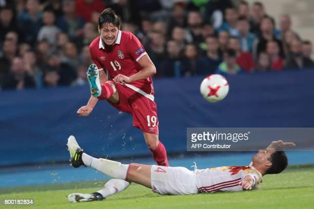 Serbia's midfielder Sasa Lukic and Spain's midfielder Mikel Merino vie for the ball during the UEFA U21 European Championship Group B football match...